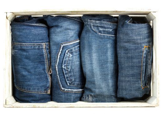 Blue jeans trouser over old grungy wooden box